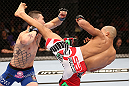 RIO DE JANEIRO, BRAZIL - OCTOBER 13:  (R-L) Diego Brandao kicks Joey Gambino during their featherweight fight at UFC 153 inside HSBC Arena on October 13, 2012 in Rio de Janeiro, Brazil.  (Photo by Josh Hedges/Zuffa LLC/Zuffa LLC via Getty Images)