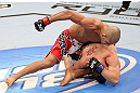 RIO DE JANEIRO, BRAZIL - OCTOBER 13:  (L-R) Diego Brandao punches Joey Gambino during their featherweight fight at UFC 153 inside HSBC Arena on October 13, 2012 in Rio de Janeiro, Brazil.  (Photo by Josh Hedges/Zuffa LLC/Zuffa LLC via Getty Images)
