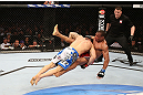 RIO DE JANEIRO, BRAZIL - OCTOBER 13:  (L-R) Gleison Tibau takes down Francisco Trinaldo during their lightweight fight at UFC 153 inside HSBC Arena on October 13, 2012 in Rio de Janeiro, Brazil.  (Photo by Josh Hedges/Zuffa LLC/Zuffa LLC via Getty Images)
