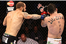 "RIO DE JANEIRO, BRAZIL - OCTOBER 13:  (L-R) Sam Sicilia punches Rony ""Jason"" Mariano Bezerra during their featherweight fight at UFC 153 inside HSBC Arena on October 13, 2012 in Rio de Janeiro, Brazil.  (Photo by Josh Hedges/Zuffa LLC/Zuffa LLC via Getty Images)"
