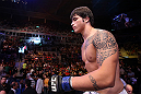 RIO DE JANEIRO, BRAZIL - OCTOBER 13:  Erick Silva enters the Octagon before his welterweight fight against Jon Fitch at UFC 153 inside HSBC Arena on October 13, 2012 in Rio de Janeiro, Brazil.  (Photo by Josh Hedges/Zuffa LLC/Zuffa LLC via Getty Images)