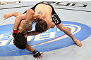 RIO DE JANEIRO, BRAZIL - OCTOBER 13:  (R-L) Jon Fitch takes down Erick Silva during their welterweight fight at UFC 153 inside HSBC Arena on October 13, 2012 in Rio de Janeiro, Brazil.  (Photo by Josh Hedges/Zuffa LLC/Zuffa LLC via Getty Images)