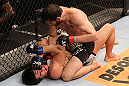 RIO DE JANEIRO, BRAZIL - OCTOBER 13:  (R-L) Jon Fitch punches Erick Silva during their welterweight fight at UFC 153 inside HSBC Arena on October 13, 2012 in Rio de Janeiro, Brazil.  (Photo by Josh Hedges/Zuffa LLC/Zuffa LLC via Getty Images)