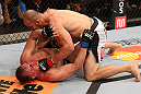 RIO DE JANEIRO, BRAZIL - OCTOBER 13:  (R-L) Glover Teixeira punches Fabio Maldonado during their light heavyweight fight at UFC 153 inside HSBC Arena on October 13, 2012 in Rio de Janeiro, Brazil.  (Photo by Josh Hedges/Zuffa LLC/Zuffa LLC via Getty Images)