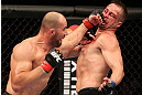 RIO DE JANEIRO, BRAZIL - OCTOBER 13:  (L-R) Glover Teixeira punches Fabio Maldonado during their light heavyweight fight at UFC 153 inside HSBC Arena on October 13, 2012 in Rio de Janeiro, Brazil.  (Photo by Josh Hedges/Zuffa LLC/Zuffa LLC via Getty Images)