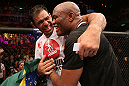 "RIO DE JANEIRO, BRAZIL - OCTOBER 13:  (R-L) Anderson Silva and his teammate Antonio Rodrigo ""Minotauro"" Nogeuira celebrate after Silva's victory over Stephan Bonnar during their light heavyweight fight at UFC 153 inside HSBC Arena on October 13, 2012 in Rio de Janeiro, Brazil.  (Photo by Josh Hedges/Zuffa LLC/Zuffa LLC via Getty Images)"