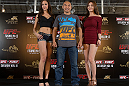 HONG KONG - NOVEMBER 07:  Tiequan Zhang (center) poses for photos with UFC Octagon Girls Jessica Cambensy (L) and Ye-Bin Kang (R) during a UFC press conference at Harbour City Mall on November 7, 2012 in Hong Kong, Hong Kong.  (Photo by Josh Hedges/Zuffa LLC/Zuffa LLC via Getty Images)