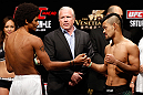 MACAU, MACAU - NOVEMBER 09:  (L-R) Opponents Alex Caceres and Motonobu Tezuka face off during the UFC Macau weigh in at Cotai Arena on November 9, 2012 in Macau, Macau.  (Photo by Josh Hedges/Zuffa LLC/Zuffa LLC via Getty Images)