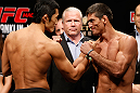 MACAU, MACAU - NOVEMBER 09:  (L-R) Opponents Dong Hyun Kim and Paulo Thiago face off during the UFC Macau weigh in at Cotai Arena on November 9, 2012 in Macau, Macau.  (Photo by Josh Hedges/Zuffa LLC/Zuffa LLC via Getty Images)