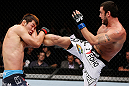 MACAU, MACAU - NOVEMBER 10: (R-L) Tom DeBlass kicks Riki Fukuda during their middleweight bout at the UFC Macao event inside CotaiArena on November 10, 2012 in Macau, Macau. (Photo by Josh Hedges/Zuffa LLC/Zuffa LLC via Getty Images)