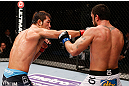 MACAU, MACAU - NOVEMBER 10:  (L-R) Riki Fukuda punches Tom DeBlass during their middleweight bout at the UFC Macao event inside CotaiArena on November 10, 2012 in Macau, Macau.  (Photo by Josh Hedges/Zuffa LLC/Zuffa LLC via Getty Images)
