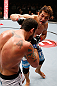 MACAU, MACAU - NOVEMBER 10: (R-L) Riki Fukuda punches Tom DeBlass during their middleweight bout at the UFC Macao event inside CotaiArena on November 10, 2012 in Macau, Macau. (Photo by Josh Hedges/Zuffa LLC/Zuffa LLC via Getty Images)