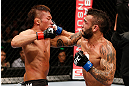 MACAU, MACAU - NOVEMBER 10:  (R-L) John Lineker and Yasuhiro Urushitani trade punches during their flyweight bout at the UFC Macao event inside CotaiArena on November 10, 2012 in Macau, Macau.  (Photo by Josh Hedges/Zuffa LLC/Zuffa LLC via Getty Images)