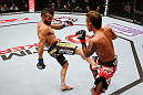 MACAU, MACAU - NOVEMBER 10: (L-R) John Lineker kicks Yasuhiro Urushitani during their flyweight bout at the UFC Macao event inside CotaiArena on November 10, 2012 in Macau, Macau. (Photo by Josh Hedges/Zuffa LLC/Zuffa LLC via Getty Images)