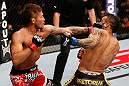 MACAU, MACAU - NOVEMBER 10:  (L-R) Yasuhiro Urushitani punches John Lineker during their flyweight bout at the UFC Macao event inside CotaiArena on November 10, 2012 in Macau, Macau.  (Photo by Josh Hedges/Zuffa LLC/Zuffa LLC via Getty Images)