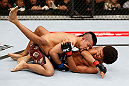 MACAU, MACAU - NOVEMBER 10:  (R-L) Alex Caceres delivers an elbow strike against Motonobu Tezuka during their bantamweight bout at the UFC Macao event inside CotaiArena on November 10, 2012 in Macau, Macau.  (Photo by Josh Hedges/Zuffa LLC/Zuffa LLC via Getty Images)