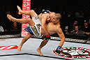 MACAU, MACAU - NOVEMBER 10: (L-R) Tiequan Zhang takes down Jon Tuck during their lightweight bout at the UFC Macao event inside CotaiArena on November 10, 2012 in Macau, Macau. (Photo by Josh Hedges/Zuffa LLC/Zuffa LLC via Getty Images)