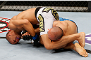 MACAU, MACAU - NOVEMBER 10: (L-R) Jon Tuck attempts an arm bar submission against Tiequan Zhang during their lightweight bout at the UFC Macao event inside CotaiArena on November 10, 2012 in Macau, Macau. (Photo by Josh Hedges/Zuffa LLC/Zuffa LLC via Getty Images)