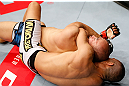 MACAU, MACAU - NOVEMBER 10: (R-L) Jon Tuck attempts a rear choke submission against Tiequan Zhang during their lightweight bout at the UFC Macao event inside CotaiArena on November 10, 2012 in Macau, Macau. (Photo by Josh Hedges/Zuffa LLC/Zuffa LLC via Getty Images)