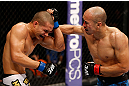 MACAU, MACAU - NOVEMBER 10: (R-L) Tiequan Zhang punches Jon Tuck during their lightweight bout at the UFC Macao event inside CotaiArena on November 10, 2012 in Macau, Macau. (Photo by Josh Hedges/Zuffa LLC/Zuffa LLC via Getty Images)