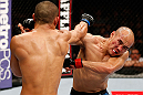 MACAU, MACAU - NOVEMBER 10: (L-R) Jon Tuck punches Tiequan Zhang during their lightweight bout at the UFC Macao event inside CotaiArena on November 10, 2012 in Macau, Macau. (Photo by Josh Hedges/Zuffa LLC/Zuffa LLC via Getty Images)