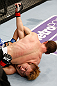 MACAU, MACAU - NOVEMBER 10: (R-L) Mac Danzig attempts a guillotine choke against Takanori Gomi during their lightweight bout at the UFC Macao event inside CotaiArena on November 10, 2012 in Macau, Macau. (Photo by Josh Hedges/Zuffa LLC/Zuffa LLC via Getty Images)