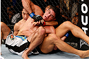 MACAU, MACAU - NOVEMBER 10: (R-L) Paulo Thiago and Dong Hyun Kim grapple for position during their welterweight bout at the UFC Macao event inside CotaiArena on November 10, 2012 in Macau, Macau. (Photo by Josh Hedges/Zuffa LLC/Zuffa LLC via Getty Images)