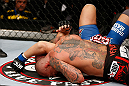 MACAU, MACAU - NOVEMBER 10: (R-L) Thiago Silva secures an arm triangle choke submission against Stanislav Nedkov during their light heavyweight bout at the UFC Macao event inside CotaiArena on November 10, 2012 in Macau, Macau. (Photo by Josh Hedges/Zuffa LLC/Zuffa LLC via Getty Images)