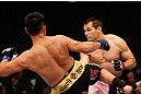 MACAU, MACAU - NOVEMBER 10: (L-R) Cung Le kicks Rich Franklin during their middleweight bout at the UFC Macao event inside CotaiArena on November 10, 2012 in Macau, Macau. (Photo by Josh Hedges/Zuffa LLC/Zuffa LLC via Getty Images)
