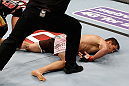 MACAU, MACAU - NOVEMBER 10: Rich Franklin lays on the canvas after being knocked out by Cung Le during their middleweight bout at the UFC Macao event inside CotaiArena on November 10, 2012 in Macau, Macau. (Photo by Josh Hedges/Zuffa LLC/Zuffa LLC via Getty Images)