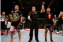 MACAU, MACAU - NOVEMBER 10: Cung Le (R) reacts after knocking out Rich Franklin during their middleweight bout at the UFC Macao event inside CotaiArena on November 10, 2012 in Macau, Macau. (Photo by Josh Hedges/Zuffa LLC/Zuffa LLC via Getty Images)