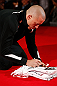 MONTREAL, CANADA - NOVEMBER 15:  Georges St-Pierre signs an autograph in the Octagon during an open training session ahead of UFC 154 at New City Gas on November 15, 2012 in Montreal, Quebec, Canada.  (Photo by Josh Hedges/Zuffa LLC/Zuffa LLC via Getty Images)