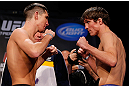 MONTREAL, CANADA - NOVEMBER 16:  (L-R) Opponents Steven Siler and Darren Elkins face off during the official UFC 154 weigh in at New City Gas on November 16, 2012 in Montreal, Quebec, Canada.  (Photo by Josh Hedges/Zuffa LLC/Zuffa LLC via Getty Images)