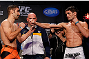 MONTREAL, CANADA - NOVEMBER 16:  (L-R) Opponents Antonio Carvalho and Rodrigo Damm face off during the official UFC 154 weigh in at New City Gas on November 16, 2012 in Montreal, Quebec, Canada.  (Photo by Josh Hedges/Zuffa LLC/Zuffa LLC via Getty Images)