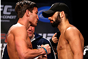 MONTREAL, CANADA - NOVEMBER 16:  (L-R) Opponents Sam Stout and John Makdessi face off during the official UFC 154 weigh in at New City Gas on November 16, 2012 in Montreal, Quebec, Canada.  (Photo by Josh Hedges/Zuffa LLC/Zuffa LLC via Getty Images)