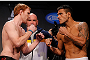 MONTREAL, CANADA - NOVEMBER 16:  (L-R) Opponents Mark Bocek and Rafael dos Anjos face off during the official UFC 154 weigh in at New City Gas on November 16, 2012 in Montreal, Quebec, Canada.  (Photo by Josh Hedges/Zuffa LLC/Zuffa LLC via Getty Images)