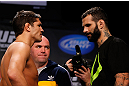 MONTREAL, CANADA - NOVEMBER 16:  (L-R) Opponents Patrick Cote and Alessio Sakara face off during the official UFC 154 weigh in at New City Gas on November 16, 2012 in Montreal, Quebec, Canada.  (Photo by Josh Hedges/Zuffa LLC/Zuffa LLC via Getty Images)