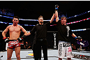 MONTREAL, QC - NOVEMBER 17:  Darren Elkins (R) celebrates after defeating Steven Siler in their featherweight bout during UFC 154 on November 17, 2012  at the Bell Centre in Montreal, Canada.  (Photo by Josh Hedges/Zuffa LLC/Zuffa LLC via Getty Images)