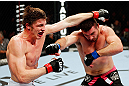 MONTREAL, QC - NOVEMBER 17:  John Maguire (L) and Matthew Riddle throw punches at each other in their welterweight bout during UFC 154 on November 17, 2012  at the Bell Centre in Montreal, Canada.  (Photo by Josh Hedges/Zuffa LLC/Zuffa LLC via Getty Images)