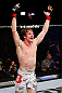 MONTREAL, QC - NOVEMBER 17:  Matthew Riddle celebrates afterfighting against John Maguire in their welterweight bout during UFC 154 on November 17, 2012  at the Bell Centre in Montreal, Canada.  (Photo by Josh Hedges/Zuffa LLC/Zuffa LLC via Getty Images)
