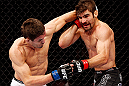 MONTREAL, QC - NOVEMBER 17:  Rodrigo Damm (L) throws a punch against Antonio Carvalho in their featherweight bout during UFC 154 on November 17, 2012  at the Bell Centre in Montreal, Canada.  (Photo by Josh Hedges/Zuffa LLC/Zuffa LLC via Getty Images)