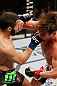 MONTREAL, QC - NOVEMBER 17:  John Makdessi (L) connects on a punch against Sam Stout in their lightweight bout during UFC 154 on November 17, 2012  at the Bell Centre in Montreal, Canada.  (Photo by Josh Hedges/Zuffa LLC/Zuffa LLC via Getty Images)