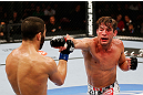 MONTREAL, QC - NOVEMBER 17:  Sam Stout (R) throws a punch against John Makdessi in their lightweight bout during UFC 154 on November 17, 2012  at the Bell Centre in Montreal, Canada.  (Photo by Josh Hedges/Zuffa LLC/Zuffa LLC via Getty Images)