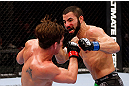 MONTREAL, QC - NOVEMBER 17:  John Makdessi (R) throws a punch against Sam Stout in their lightweight bout during UFC 154 on November 17, 2012  at the Bell Centre in Montreal, Canada.  (Photo by Josh Hedges/Zuffa LLC/Zuffa LLC via Getty Images)