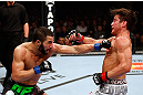 MONTREAL, QC - NOVEMBER 17:  John Makdessi (L) throws a punch against Sam Stout in their lightweight bout during UFC 154 on November 17, 2012  at the Bell Centre in Montreal, Canada.  (Photo by Josh Hedges/Zuffa LLC/Zuffa LLC via Getty Images)