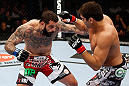MONTREAL, QC - NOVEMBER 17:  Alessio Sakara (L) throws a punch against Patrick Cote in their middleweight bout during UFC 154 on November 17, 2012  at the Bell Centre in Montreal, Canada.  (Photo by Josh Hedges/Zuffa LLC/Zuffa LLC via Getty Images)
