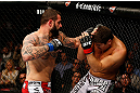 MONTREAL, QC - NOVEMBER 17:  Alessio Sakara (L) throws a punch against Patrick Cote during their middleweight bout during UFC 154 on November 17, 2012  at the Bell Centre in Montreal, Canada.  (Photo by Josh Hedges/Zuffa LLC/Zuffa LLC via Getty Images)