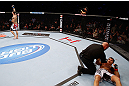 MONTREAL, QC - NOVEMBER 17:  Referee Dan Miragliotta calls the fight after Alessio Sakara (L) punched Patrick Cote in the back of the head multiple times during their middleweight bout during UFC 154 on November 17, 2012  at the Bell Centre in Montreal, Canada. Sakara was later disqualified for the illegal punches.  (Photo by Josh Hedges/Zuffa LLC/Zuffa LLC via Getty Images)