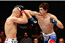 MONTREAL, QC - NOVEMBER 17:  Pablo Garza (R) throws an elbow against Mark Hominick in their featherweight bout during UFC 154 on November 17, 2012  at the Bell Centre in Montreal, Canada.  (Photo by Josh Hedges/Zuffa LLC/Zuffa LLC via Getty Images)