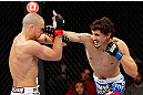 MONTREAL, QC - NOVEMBER 17:  Pablo Garza (R)) connects on a punch against Mark Hominick in their featherweight bout during UFC 154 on November 17, 2012  at the Bell Centre in Montreal, Canada.  (Photo by Josh Hedges/Zuffa LLC/Zuffa LLC via Getty Images)